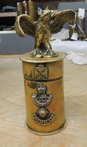 A shell case in the Durham Light Infantry Museum. The cross and eagle had been incorrectly assessed as German. The piece was most likely owned by a British padre.